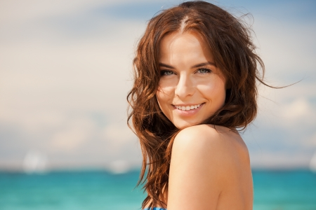 bright picture of beautiful woman on a beachの写真素材