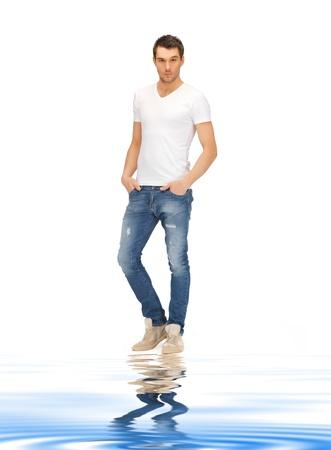 Photo pour bright picture of handsome man on white sand - image libre de droit