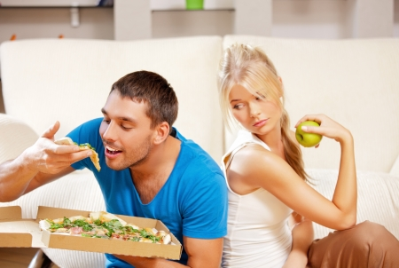bright picture of couple eating different food  focus on man