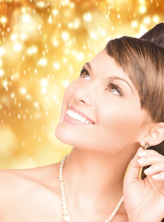 bright picture of lovely woman with pearls