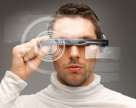 Photo pour picture of handsome man with futuristic glasses - image libre de droit