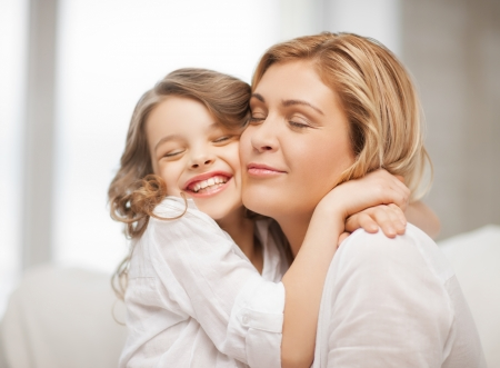 Photo pour bright picture of hugging mother and daughter - image libre de droit