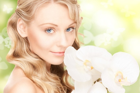 picture of beautiful woman with orchid flower and butterfliesの写真素材