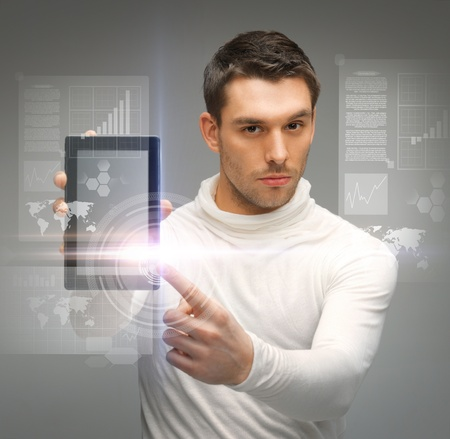 picture of man with tablet pc and virtual screens