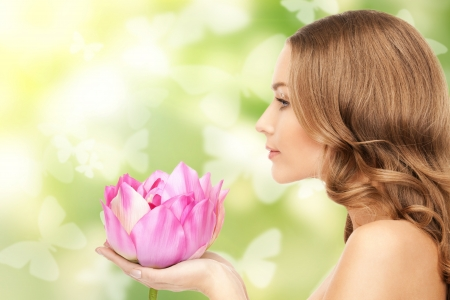 picture of beautiful woman with lotus flower and butterflies