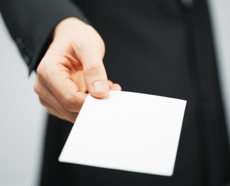 picture of man in suit holding credit card
