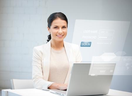 Photo pour picture of happy woman with laptop computer and virtual screen - image libre de droit