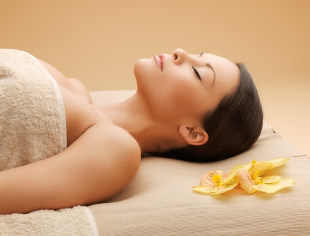 picture of woman in spa salon lying on the massage desk
