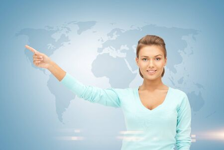 businesswoman pointing her finger at world map