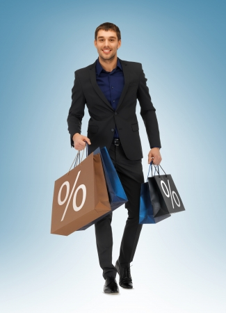 picture of handsome man with shopping bags