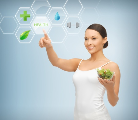 Photo for woman holding salad and working with menu on virtual screen - Royalty Free Image