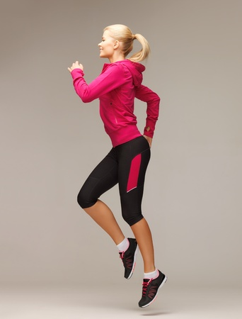 picture of beautiful sporty woman running or jumping