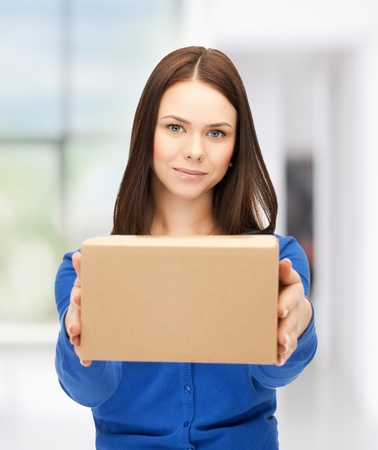 picture of attractive businesswoman delivering box
