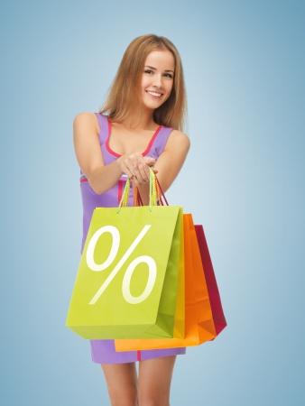 picture of attractive woman carrying shopping bags
