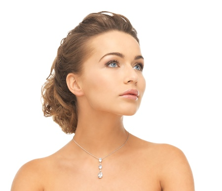 close-up of beautiful woman wearing shiny diamond necklace