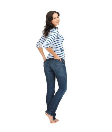Foto de picture of beautiful young woman wearing jeans - Imagen libre de derechos