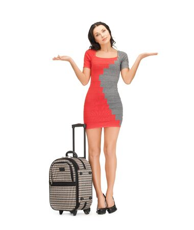 picture of doubting woman in dress with suitcase