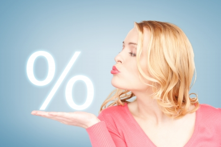 picture of woman showing sign of percent in her hand
