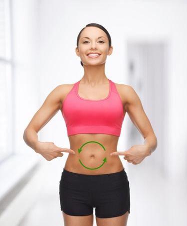 picture of beautiful sporty woman with arrows on her stomach