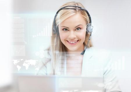 futuristic female helpline operator with headphones and virtual screen