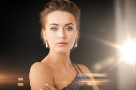beautiful woman in evening dress wearing diamond earrings