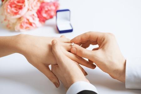 Foto de picture of man putting  wedding ring on woman hand - Imagen libre de derechos