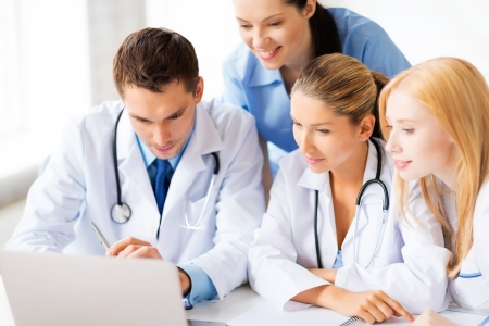 Photo pour picture of young team or group of doctors working - image libre de droit
