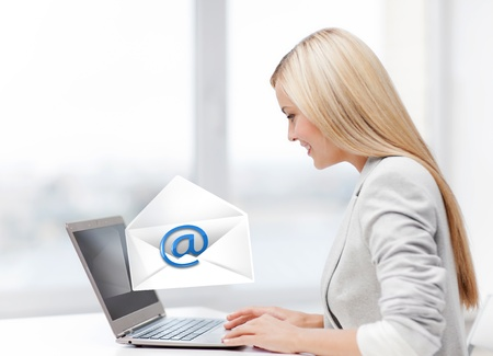 picture of beautiful woman with laptop computer sending email