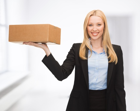 attractive young businesswoman delivering cardboard box indoor