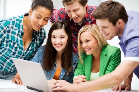 Photo pour education and internet - smiling students looking at tablet pc in lecture at school - image libre de droit