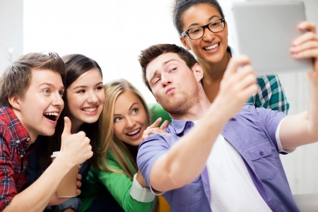 Photo pour technology concept - group of students making picture with tablet pc - image libre de droit