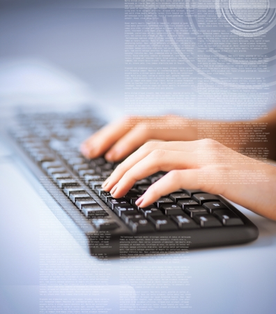 business, education and technology concept - woman hands typing on keyboard