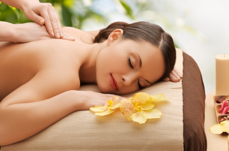 Foto de beauty, holidays and spa concept - woman in spa salon getting massage - Imagen libre de derechos