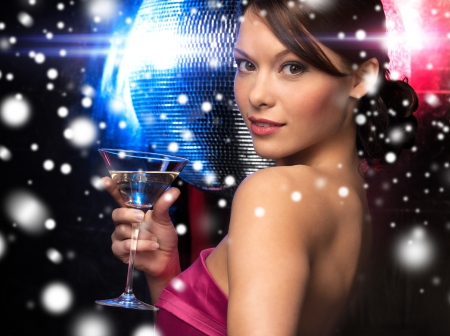 luxury, vip, nightlife, party, christmas, x-mas, new year's eve concept - beautiful woman in evening dress with cocktail and disco ball