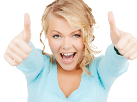 happy people concept - bright picture of young businesswoman with thumbs up