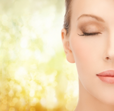 health, spa and beauty concept - close up of face of beautiful young woman