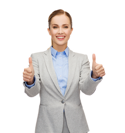 business, gesture and office concept - smiling businesswoman showing thumbs up