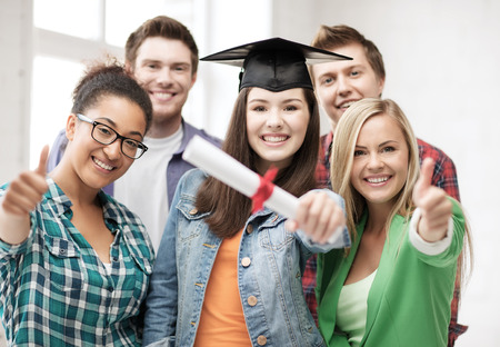 education concept - happy girl in graduation cap with diploma and students