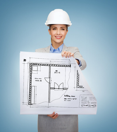 building, developing, consrtuction and architecture concept - friendly young smiling architect in white helmet with blueprints