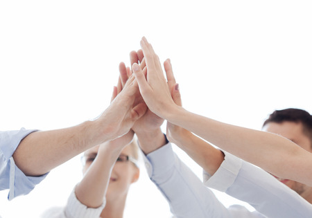 Photo for success and winning concept - happy business team giving high five in office - Royalty Free Image