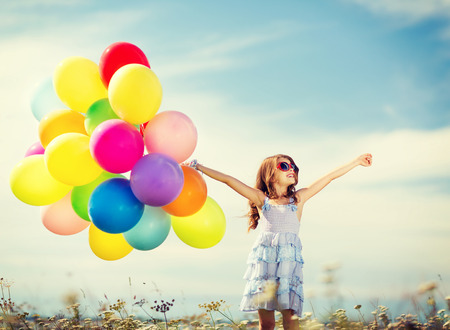 Photo for summer holidays, celebration, family, children and people concept - happy girl with colorful balloons - Royalty Free Image