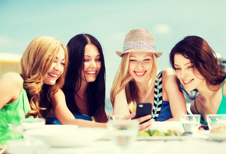Summer Holidays Vacation And Technology Girls Looking At