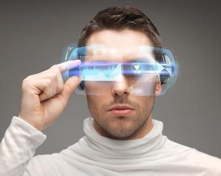 Foto de future, technology and people concept - man in futuristic glasses - Imagen libre de derechos