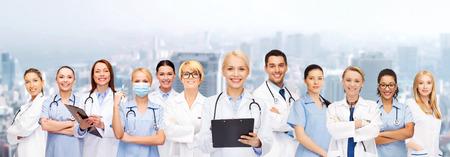 Photo pour healthcare and medicine concept - smiling female doctors and nurses with stethoscope - image libre de droit