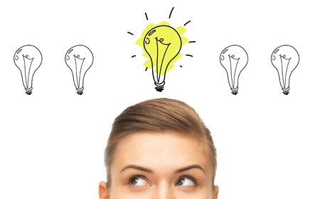 idea, business, education and people concept - close up of beautiful female eyes looking up to lighting bulb doodles