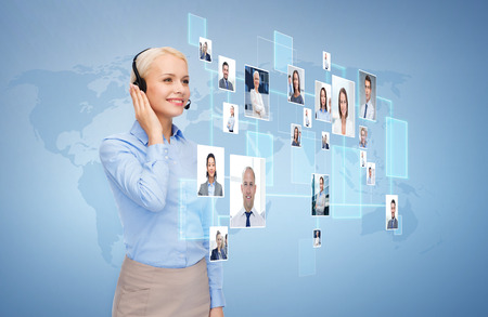 Photo pour business, communication, cooperation and people concept - happy female helpline operator with headset over blue background and icons of contacts or customers - image libre de droit