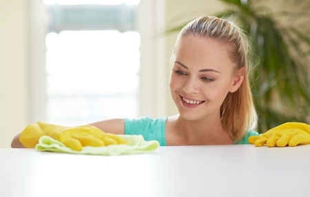 Photo for people, housework and housekeeping concept - happy woman cleaning table at home kitchen - Royalty Free Image
