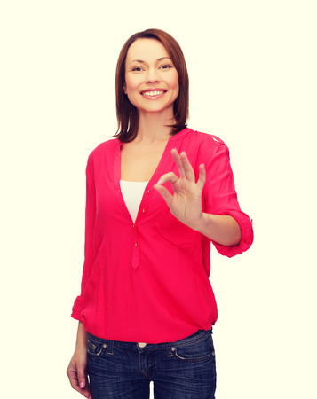 happy people concept - smiling woman in casual clothes showing ok gesture