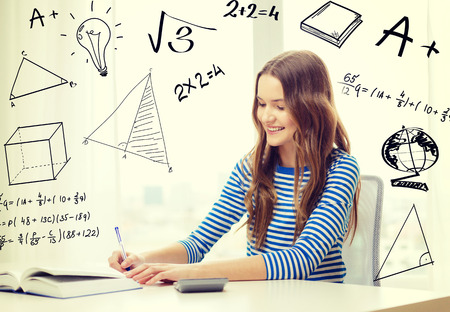 education, technology and home concept - smiling student girl with book, notebook and calculator