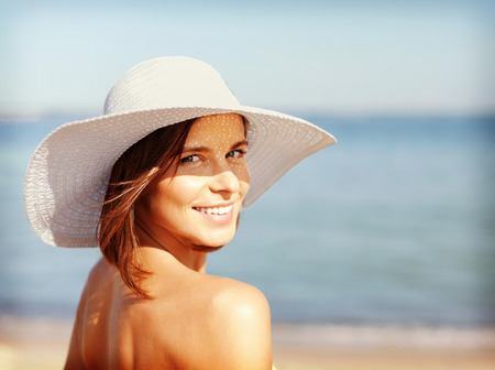 Foto de summer holidays and vacation concept - girl in bikini standing on the beach - Imagen libre de derechos